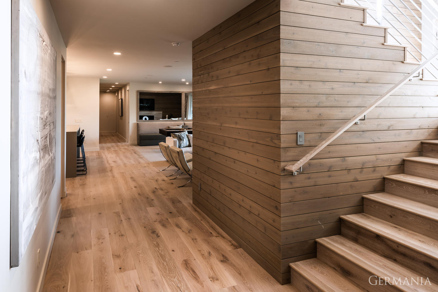 Germania can execute the design of your dream home with gorgeous natural wood flooring and modern paneling.