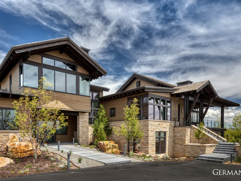 Considering building a custom luxury home? Featured here is one of many luxury builds by Germania. The driveway, stone veneer, and custom walk paths are some of the craftmanship you can expect.